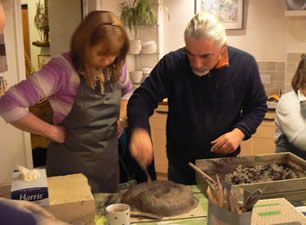 Evening session in kitchen developing design ideas and creating the clay maquettes